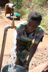 Malawian Woman Getting Water from Tap
